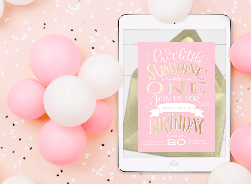 1st birthday invitations: a birthday evite on a tablet, surrounded by balloons and confetti