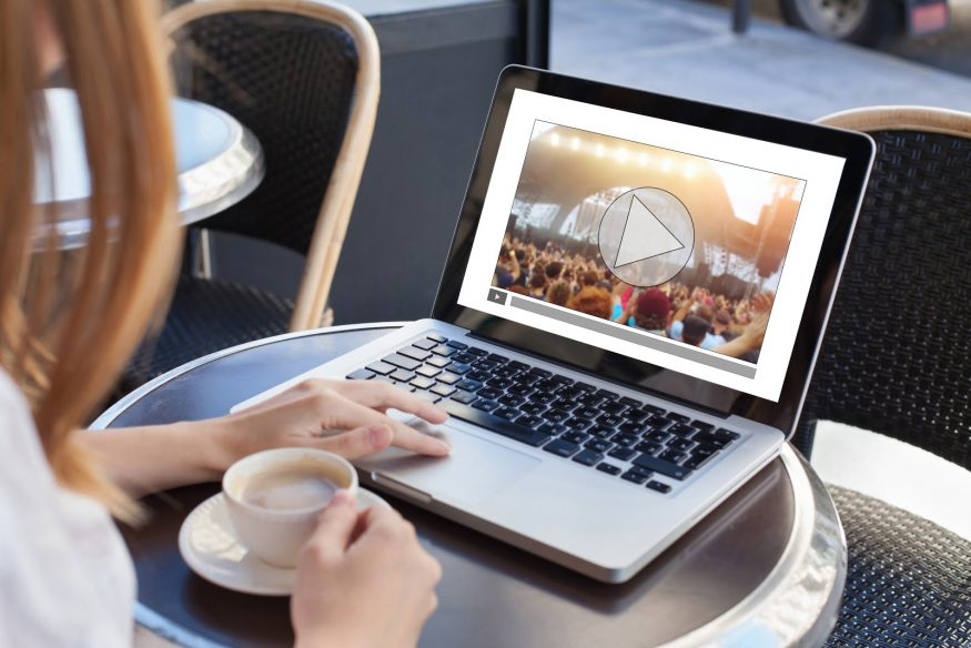 Virtual parties: A woman watches a concert on her laptop