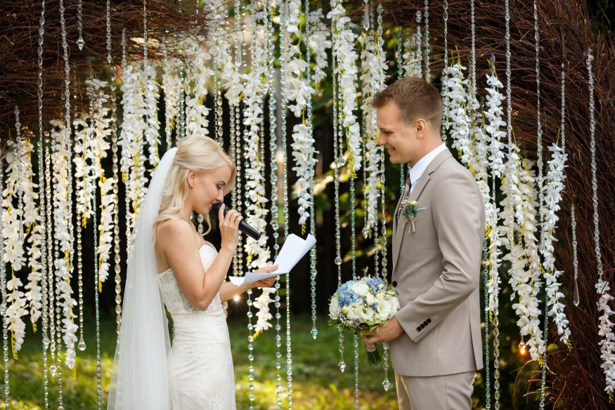 Marriage quotes: A bride and groom read their vows at the altar