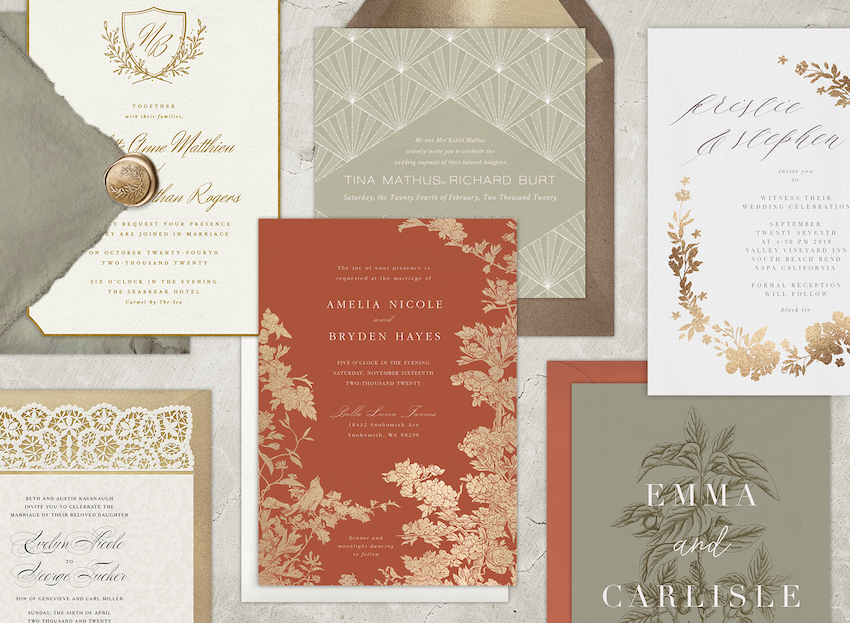 Six vintage wedding invitations laid out with their envelopes