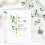 An all-in-one wedding invitation with matching envelope, ribbon, and greenery