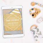 A digital baby sprinkle invitation on a tablet next to baby toys