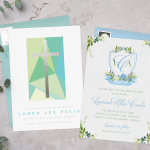 Two baptism invitations surrounded by sprigs of greenery