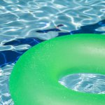 Pool party invitations: an inner tube floating in a pool