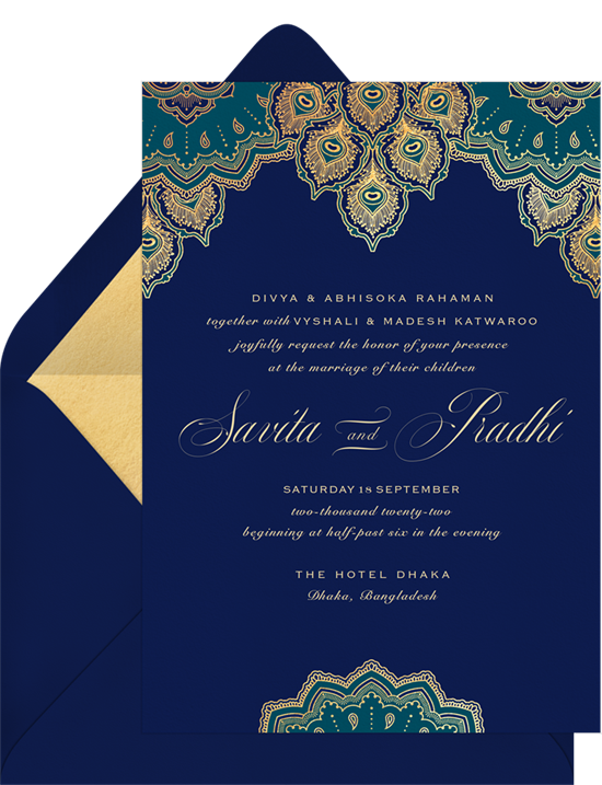 A blue, Indian wedding invitation with peacock-inspired mandalas and formal wedding invitation wording