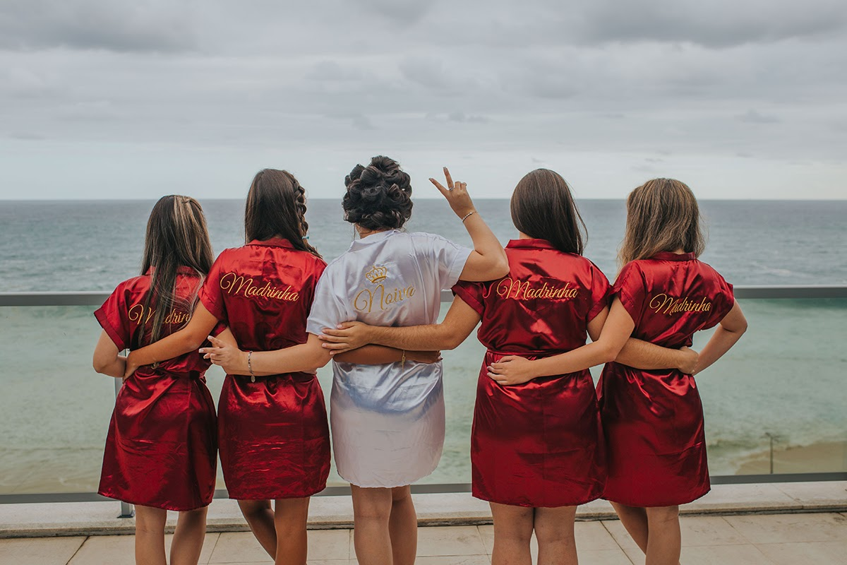 A Bride and her bridesmaids in matching robes