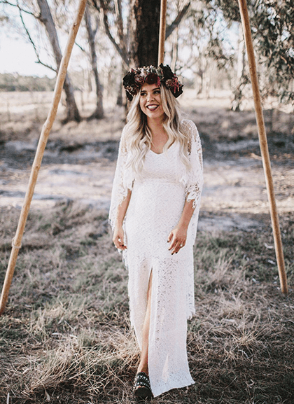 Smiling bride with deep red floral crown