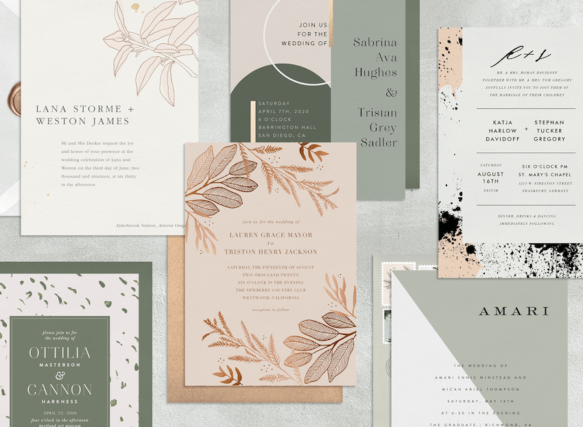 Six modern wedding invitations laid out with their envelopes