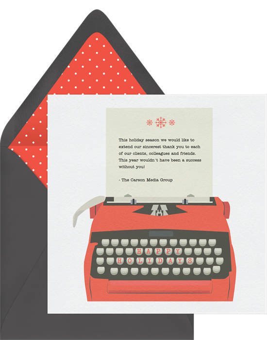 A card that features a type writer with room for one of the longer Christmas card greetings