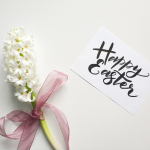 Spring flowers with a ribbon and happy Easter card