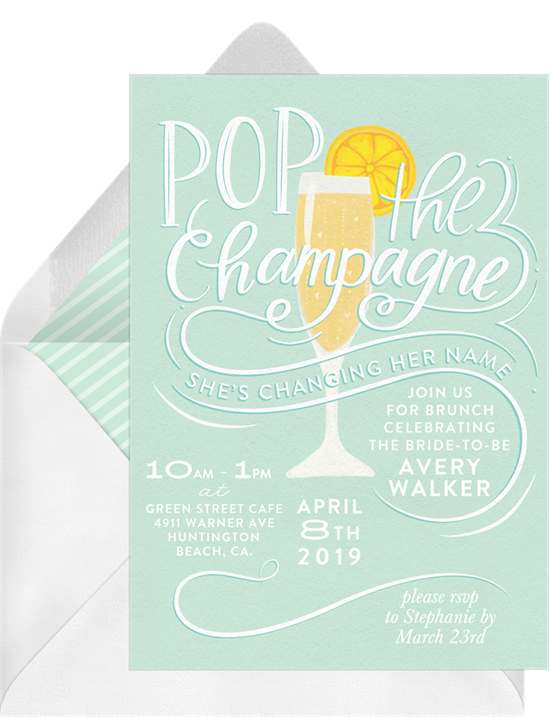 """Bridal shower invitation wording: an invitation that reads, """"Pop the Champagne, She's Changing Her Name"""""""