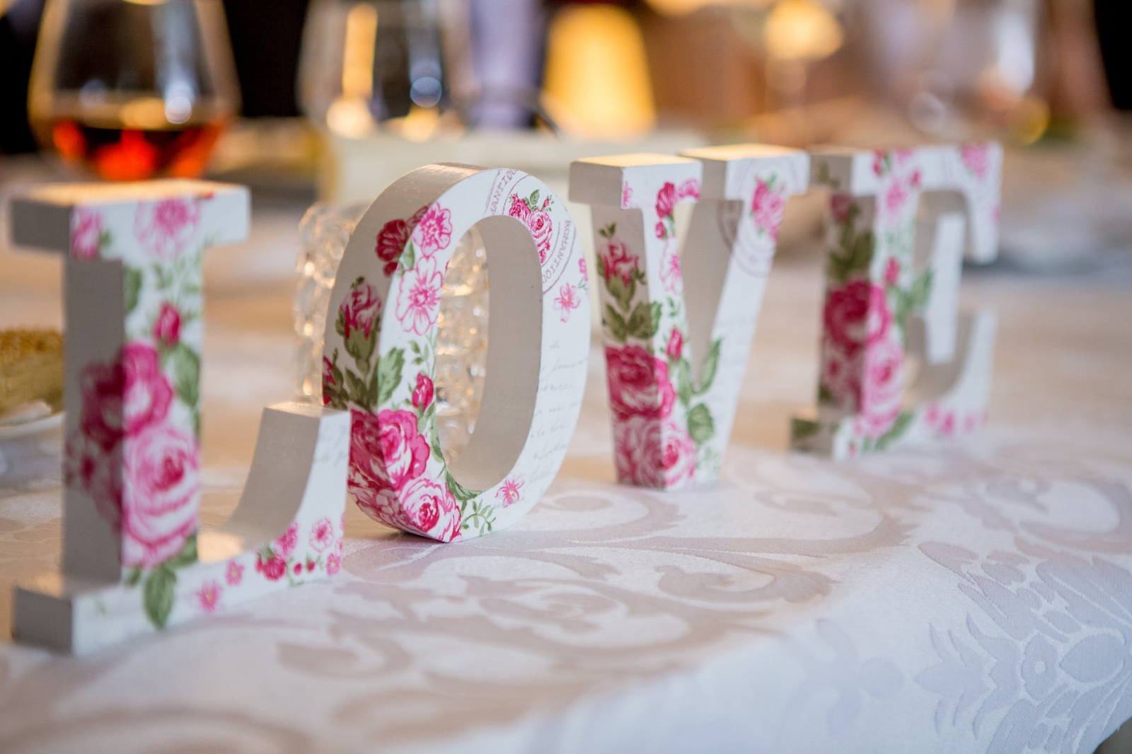 "Wedding words: a reception table with block letters that spell ""LOVE"""