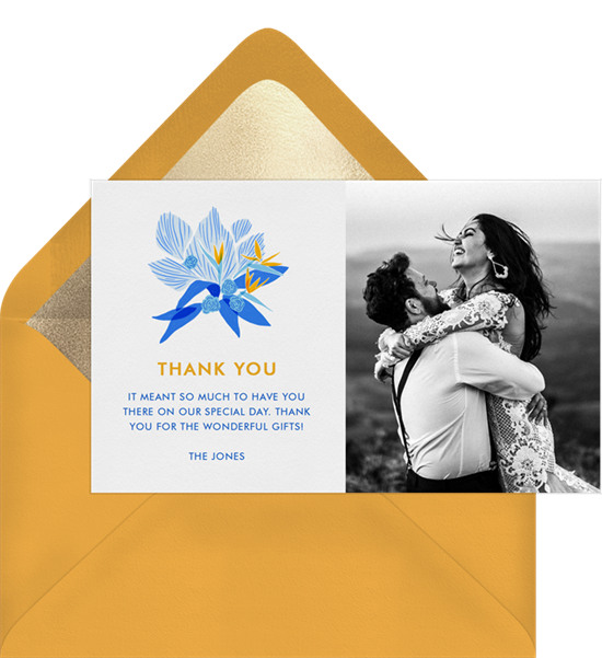 Blue and yellow wedding thank you cards featuring a tropical flower design and photo