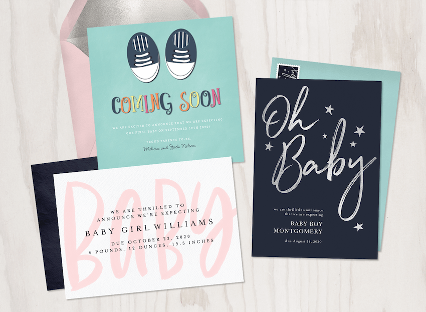 Pregnancy announcement ideas: Three pregnancy announcement cards laid out on a wood background