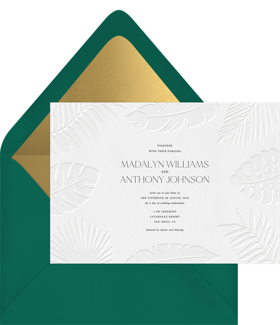 Subtle tropical wedding invitation examples with white letterpress palm fronts on white invitations