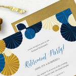 A retirement party invitation laid out with an envelope, champagne cork, and champagne foil