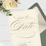 Save the date ideas: a save the date card with an envelope, flowers, and a ribbon