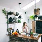 A woman looks around her new kitchen