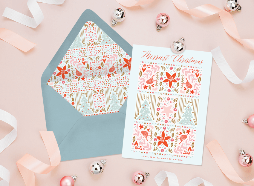 A unique Christmas card surrounded by pink ribbon and ornaments