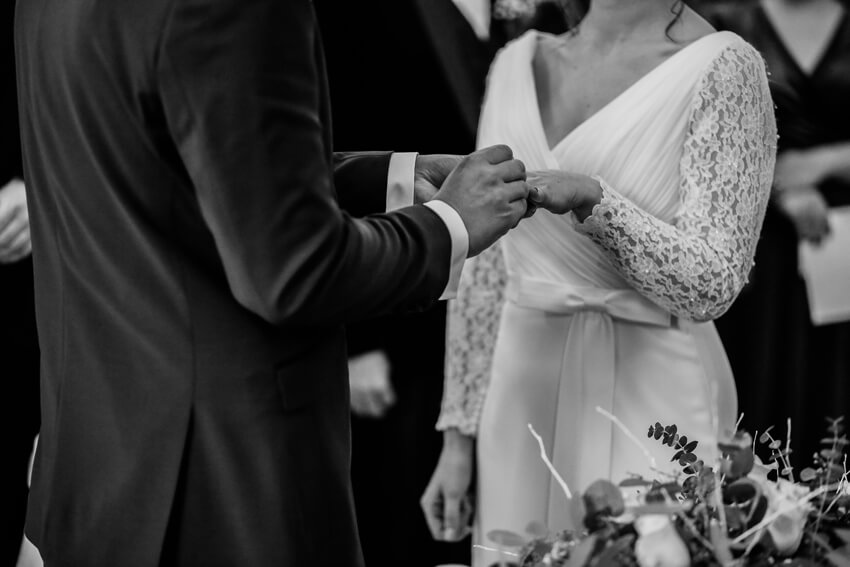 black and white wedding ceremony moment